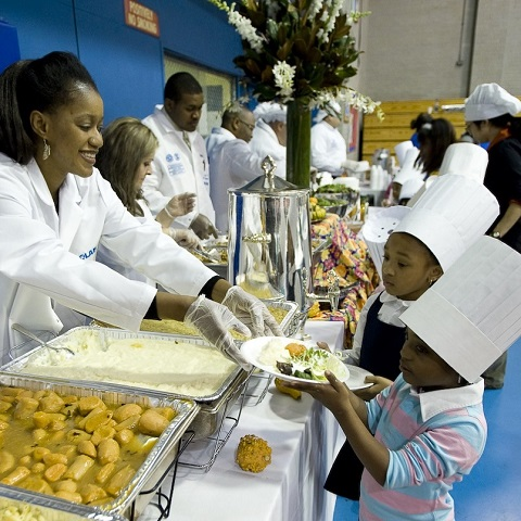Volunteer serving food