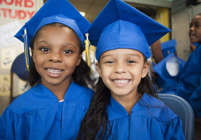 Two graduates from early childhood program
