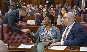 Speaker Corey Johnshon greets Fostering Youth Success Alliance Advocate Melanie Thompson